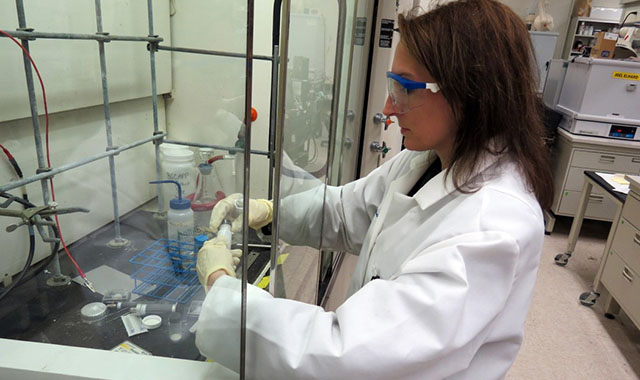 Amy Heintz working on advanced materials in a Battelle laboratory