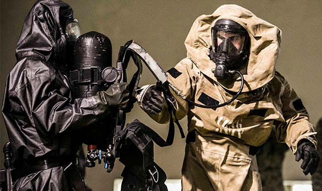 Photo: two soldiers in hazmat gear
