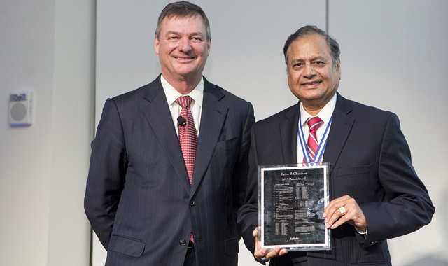 Jeff Wadsworth posing with Satya Chauhan and his award