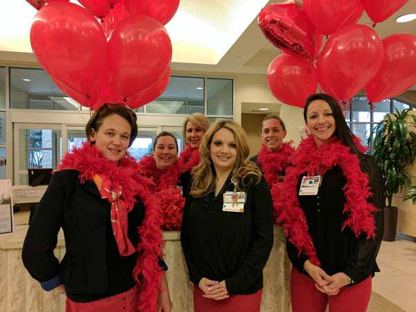 Employees wear red at Methodist Texsan Hospital
