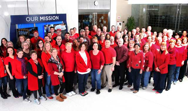 Employees wearing red