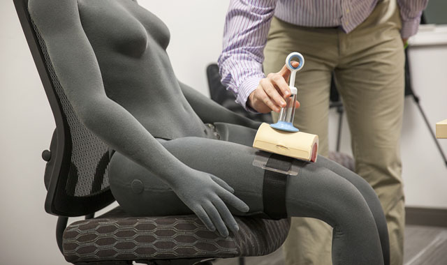 researcher testing the usability of a medical device