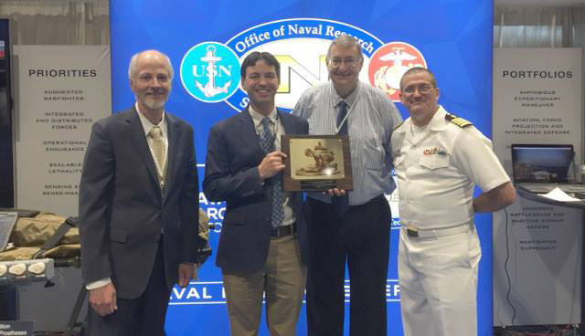 Battelle and officials from Office of Naval Research pose for photo