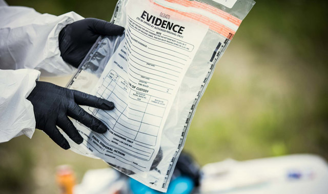 investigator holding an evidence bag