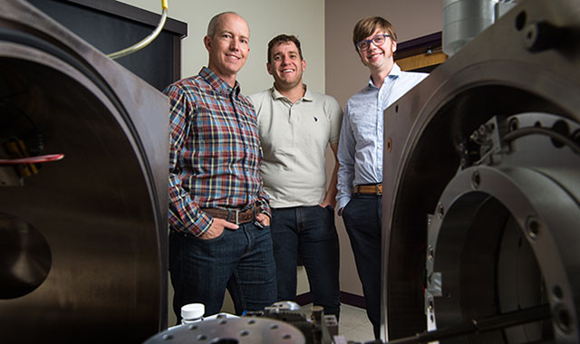 NREL researchers Bryon Donohoe and Nic Rorrer and Gregg Beckham pose in the lab