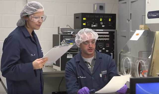 David Pressburger and Amy Zmarowski working in the lab