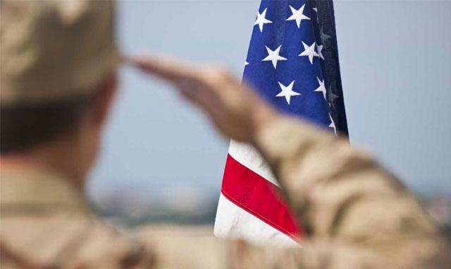 Photo of U.S. soldier saluting flag