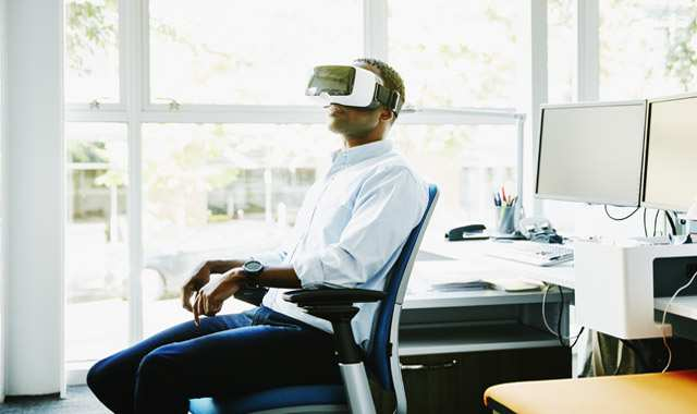 man using a VR headset in an office setting